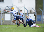 Mark Rodgers of Scariff Community College celebrate s their first goal despite opposition goalie Cathal Dunne of St Fergal's College during their All-Ireland Colleges final at Toomevara. Photograph by John Kelly.