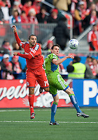 Dwayne DeRosario (14) of Toronto FC and Sebastien LeToux (right) of Seattle Sounders FC during MLS action against Seattle at BMO Field in Toronto on April 4, 2009. Seattle won 2-0. Photo by Nick Turchiaro/isiphotos.com.