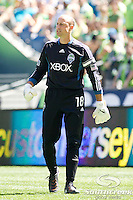 Seattle Sounders FC goalkeeper Kasey Keller (18) yells to a teammate in a match against Columbus Crew at CenturyLink Field in Seattle, Washington. The Sounders defeated Columbus Crew, 6-2.