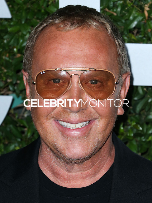 BEVERLY HILLS, CA, USA - OCTOBER 02: Michael Kors arrives at Michael Kors Launch Of Claiborne Swanson Franks's 'Young Hollywood' Book held at a Private Residence on October 2, 2014 in Beverly Hills, California, United States. (Photo by Xavier Collin/Celebrity Monitor)