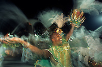 Samba Schools Parade in Sambodromo, Rio de Janeiro Carnival, Brazil - ecstasy of samba dancer holding king crown, an adornment part of his costume.