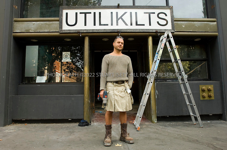 10/9/2006--Seattle, WA, USA..'Utilikilts' for Sale in Seattle. Steven Villegas owner of this unique Seattle clothier that has pioneered a comfortable alternative to trousers in the form of pocketed knee-length skirts for men. Utilikilts, located in an alley warehouse near Pioneer Square, peddles eight varieties of the garments including cotton, leather, duck cloth and lightweight nylon. The company is about to move into a new storefront (shown here) in Seattle's downtown historic Pioneer District....Photograph By Stuart Isett.All photographs ©2006 Stuart Isett.All rights reserved.
