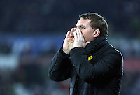 SWANSEA, WALES - MARCH 16: Liverpool manager Brendan Rodgers shouts instructions to his players during the Premier League match between Swansea City and Liverpool at the Liberty Stadium on March 16, 2015 in Swansea, Wales