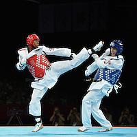 Lutalo Muhammad (GBR) (red) fights Farkhod Negmatov (TJK).Taekwondo.ExCel Arena.Olympics 2012.London UK. .10/08/12,.photo: Sean Ryan / IPS Photo Agency.. mobile: 07971 400 939.Address: Thatched Cottage,Wretham,Thetford, Norfolk IP24 1RH .Office tel: 01953 499 403...