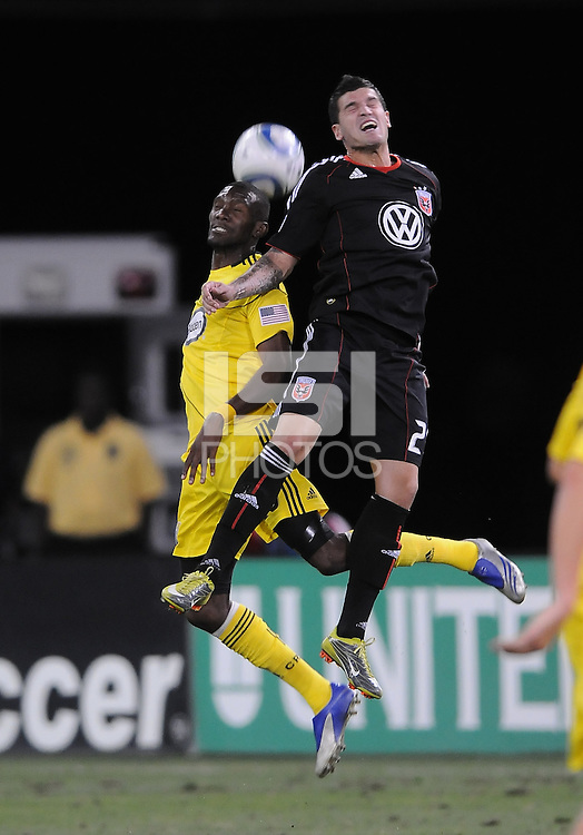 Columbus Crew defender Shaun Francis (29) heads the ball against DC United midfielder Santino Quaranta (25).  The Columbus Crew defeated DC united 1-0, at RFK Stadium, Saturday September 4, 2010.