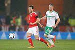 Adam Matthews of Wales and Conor Washington of Northern Ireland during the international friendly match at the Cardiff City Stadium. Photo credit should read: Philip Oldham/Sportimage