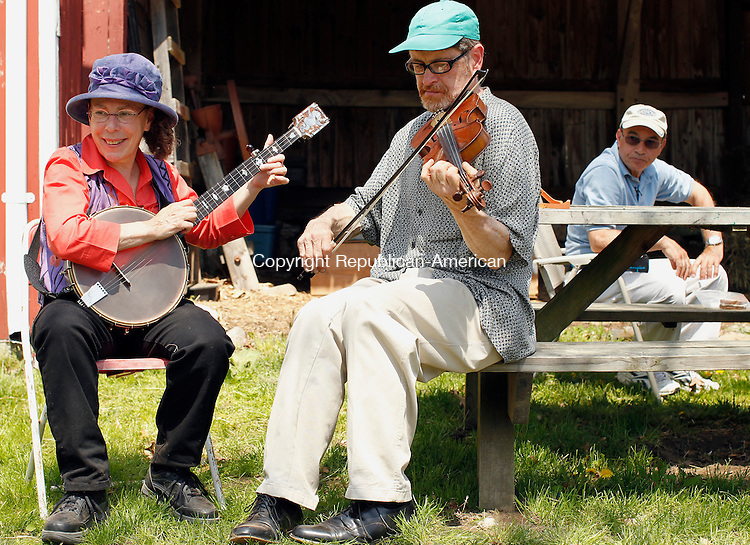 Woodbury, CT-01, May 2010-050110CM15 COUNTRY LIFE USE Down Home Frolic's Fran Block (left) plays the banjo as Dan Gardella plays the fiddle, Saturday afternoon at the Woodbury Farm Day, at the Flander's Nature Center.   --Christopher Massa Republican-American