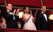 United States President Barack Obama and First Lady Michelle Obama attend the program recognizing the 37th Kennedy Center Honorees at the John F. Kennedy Center for the Performing Arts in Washington, D.C. on Sunday, December 7, 2014. From left to right: Tom Hanks, the first lady and the President.  <br /> Credit: Dennis Brack / Pool via CNP