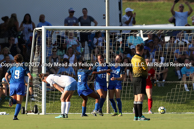 CARY, NC - AUGUST 18: Duke's Taylor Racioppi (7) celebrates her goal with Duke's Kayla McCoy (12) and Imani Dorsey (3). The University of North Carolina Tar Heels hosted the Duke University Blue Devils on August 18, 2017, at Koka Booth Stadium in Cary, NC in a Division I college soccer game.