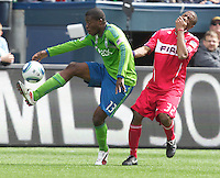 Seattle Sounders FC forward Miguel Monta?o gets contorl of the ball after colliding with Chicago Fire defender Dasan Robinsonduring play at Qwest Field in Seattle Tuesday April 8, 2011. The Sounders won the game 2-1.