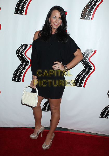 Stephanie Ronalds<br /> 13th annual Polish film festival at American Cinematheque's Egyptian Theatre, Hollywood, California, USA.<br /> 9th October 2012<br /> full length hand on hip dress black silver shoes white bag purse <br /> CAP/ADM/RE<br /> &copy;Russ Elliot/AdMedia/Capital Pictures