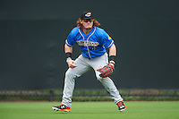 Akron RubberDucks left fielder Clint Frazier (4) breaks on a long fly ball during the first game of a doubleheader against the Bowie Baysox on June 5, 2016 at Prince George's Stadium in Bowie, Maryland.  Bowie defeated Akron 6-0.  (Mike Janes/Four Seam Images)