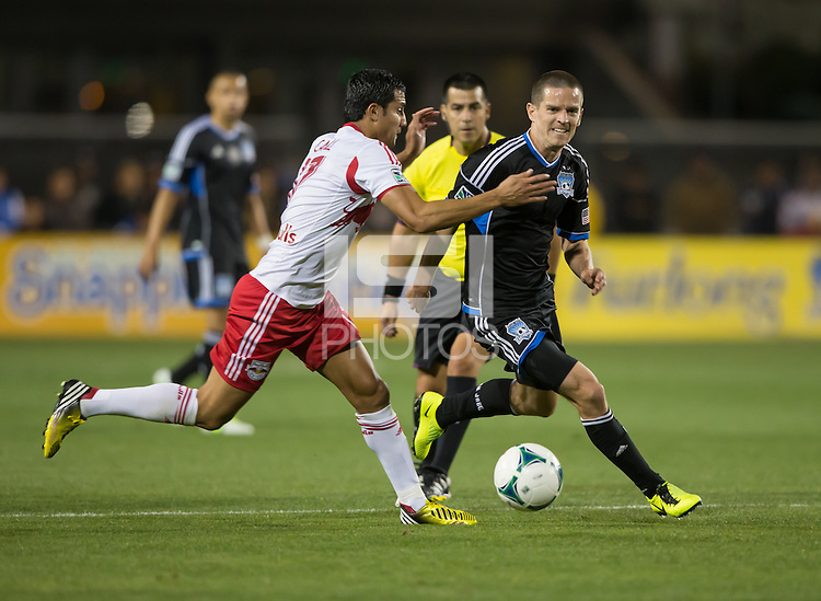 March 10th, 2013: San Cronin work with the ball away from Tim Cahill during a game at Buck Shaw Stadium, Santa Clara, Ca.   Earthquakes defeated Red Bulls 2-1