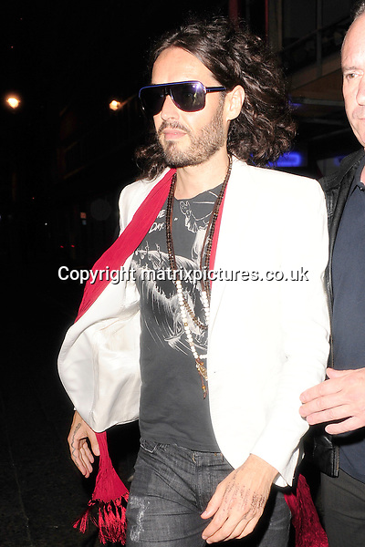 NON EXCLUSIVE PICTURE: MATRIXPICTURES.CO.UK<br /> PLEASE CREDIT ALL USES<br /> <br /> WORLD RIGHTS<br /> <br /> English comedian and actor Russell Brand pictured leaving London's Soho Theatre at 00:30, after performing his &quot;Messiah Complex&quot; show. <br /> <br /> A set-list is scribbled on his hand.<br /> <br /> JUNE 19th 2013<br /> <br /> REF: ASSI 134203