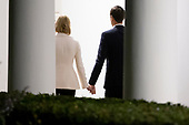 Senior Advisor to President Trump Jared Kushner (L) and his wife Ivanka Trump (R), daughter of President Trump, walk down the Colonnade after returning to the White House by Marine One, in Washington, DC, USA, 18 October 2019. The couple joined President Trump during a trip to Texas.<br /> Credit: Michael Reynolds / Pool via CNP