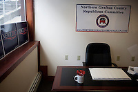 An empty desk sits at the Northern Grafton County Republican Committee offices in Littleton, New Hampshire.