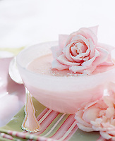Pale pink rose pudding topped with a rose and a dusting of icing sugar makes a gorgeous summer dessert