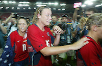 26 August 2004: Abby Wambach and Julie Foudy rush to the locker room after winning the gold medal against Brazil at Karaiskakis Stadium in Athens, Greece.   USA defeated Brazil, 2-1 in overtime.   Credit: Michael Pimentel / ISI.