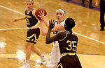 SIOUX FALLS, SD - NOVEMBER 25: Moira Duffy #34 from the University of Sioux Falls eyes the basket past Abuk Akoi #35 from Southwest Minnesota State University during their game Saturday evening at the Stewart Center in Sioux Falls. (Photo by Dave Eggen/Inertia)