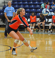 NWA Democrat-Gazette/ANDY SHUPE<br /> Elleson Dunagin of Rogers Heritage reaches to dig a ball against Springdale Har-Ber Thursday, Sept. 17, 2015, at Wildcat Arena in Springdale. Visit nwadg.com/photos to see more photographs from the game.