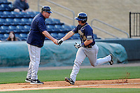 First baseman Steven Shelinsky Jr. (18) of the University of Pittsburgh Panthers is congratulated by head coach Joe Jordano after hitting a home run in a game against the Presbyterian Blue Hose on Tuesday, March 11, 2014, at Fluor Field at the West End in Greenville, South Carolina. Pitt won, 12-3. (Tom Priddy/Four Seam Images)