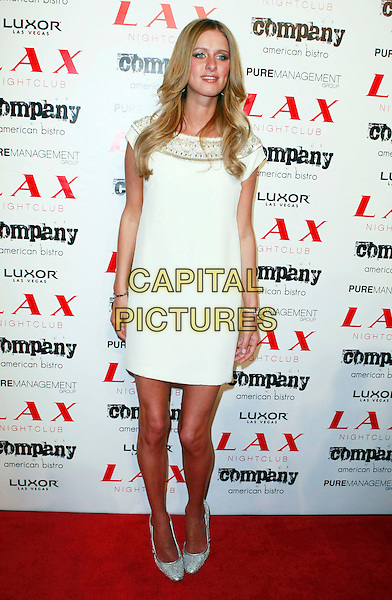 NICKY HILTON.Paris Hilton and Nicky Hilton host LAX Nightclub's New Year's Eve Bash held at the LUXOR Hotel and Casino Las Vegas, Las Vegas, Nevada, USA, 31 December, 2007..full length white cream dress gold beaded dress.CAP/ADM/MJT.©MJT/AdMedia/Capital Pictures.