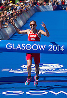 24 JUL 2014 - GLASGOW, GBR - Jodie Stimpson (ENG) from England celebrates winning the first gold medal of the 2014 Commonwealth Games at the women's  triathlon in Strathclyde Country Park, in Glasgow, Scotland (PHOTO COPYRIGHT &copy; 2014 NIGEL FARROW, ALL RIGHTS RESERVED)<br /> *******************************<br /> COMMONWEALTH GAMES <br /> FEDERATION USAGE <br /> RULES APPLY<br /> *******************************