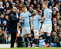 Manchester City manager Josep Guardiola issues instructions to John Stones during a break in play<br /> <br /> Photographer Rich Linley/CameraSport<br /> <br /> Emirates FA Cup Fourth Round - Manchester City v Burnley - Saturday 26th January 2019 - The Etihad - Manchester<br />  <br /> World Copyright © 2019 CameraSport. All rights reserved. 43 Linden Ave. Countesthorpe. Leicester. England. LE8 5PG - Tel: +44 (0) 116 277 4147 - admin@camerasport.com - www.camerasport.com