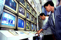 People check the stock prices from the computer screen in Hong Kong.
