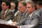 From left, Economic Analyst Jeremy Aguero, Gov. Brian Sandoval's Chief of Staff Mike Willden and Deputy Chief of Staff Chris Nielsen testify in committee at the Legislative Building in Carson City, Nev., on Thursday, May 21, 2015. <br /> Photo by Cathleen Allison