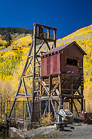 The Atlantic Cable Mine with a background of yellow Aspen trees in the town of Rico Colorado.