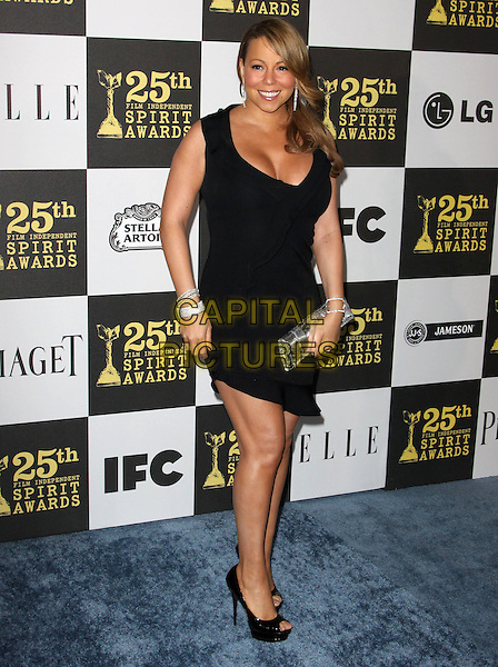 MARIAH CAREY.25th Annual Film Independent Spirit Awards held At The Nokia LA Live, Los Angeles, California, USA,.March 5th, 2010 ..arrivals Indie Spirit full length black dress cleavage sleeveless low cut peep toe platform shoes bracelets silver clutch bag .CAP/ADM/KB.©Kevan Brooks/Admedia/Capital Pictures