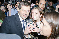 Democratic presidential candidate Pete Buttigieg greets people after an impromptu outdoor speech before a campaign event at the Currier Museum of Art in Manchester, New Hampshire, USA, on Fri., Apr. 5, 2019. The venue was filled to capacity about an hour before the candidate's arrival, so Buttigieg delivered an impromptu speech to those denied entry outside the museum before the official event. Buttigieg is the mayor of South Bend, Indiana, and was widely considered a long-shot candidate until his appearance in a CNN town hall in March 2019 which catapulted his campaign to prominence and substantial donations.