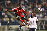 10 September 2008:  Makan Hislop (TRI)(9) takes a ball out of the air as Eddie Johnson (USA)(9) looks on.  The United States Men's National Team defeated the Trinidad and Tobago Men's National Team 3-0 at Toyota Park in Bridgeview, Illinois in a CONCACAF semifinal round FIFA 2010 South Africa World Cup Qualifier.