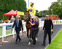 Winner of The British EBF Premier Fillies' Handicap Sea of Faith ridden by James Doyle and trained by William Haggas is led into the Winner's enclosure during Horse Racing at Salisbury Racecourse on 15th August 2019