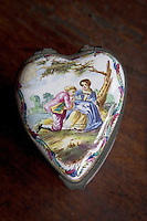 Detail of a heart-shaped box with a hand-painted love scene