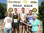 David Carrie and his mother Marie present the prizes to Mark Hoey 1st,  Carl Dunne 2nd and Eoin Callaghan 3rd in the Dunleer 4 mile run. Photo:Colin Bell/pressphotos.ie