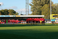 Both teams and match officials share a minutes silence to commemorate the centenary of the armistice and also the Leicester City helicopter tragedy during Crawley Town vs MK Dons, Sky Bet EFL League 2 Football at Broadfield Stadium on 3rd November 2018