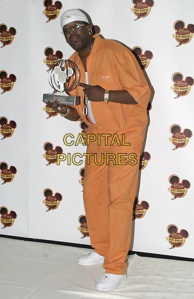 DJ CASPER.Disney Kids Awards 2004, Royal Albert Hall, London, September 16th 2004..full length holding award trophy orange tracksuit cap hat.Ref: AH.www.capitalpictures.com.sales@capitalpictures.com.©Capital Pictures....