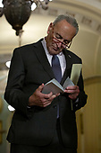 United States Senate Minority Leader Chuck Schumer (Democrat of New York) looks over notes during a press conference following weekly policy luncheons on Capitol Hill in Washington D.C., U.S. on July 30, 2019. <br /> <br /> Credit: Stefani Reynolds / CNP