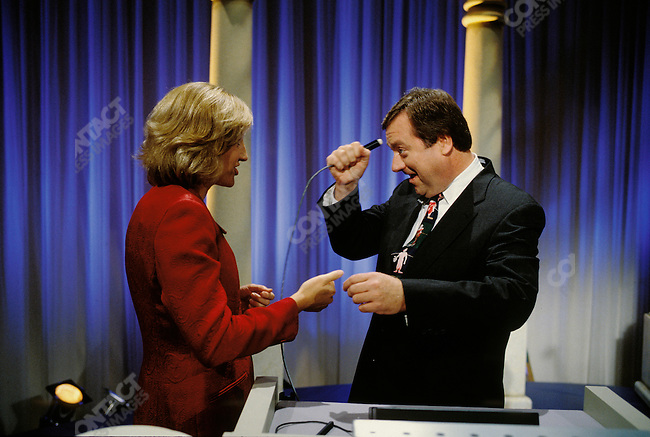 """Tim Russert with Dee Dee Meyers on """"Power Player"""" Jeopardy in Washington D.C.  November 1997."""