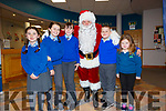 Father Christmas made a quick visit to Cahersiveen Credit Union ahead of his visit on Saturday 7th December pictured here with l-r; Lucy O'Connell, Lilly O'Brien, Nicole Devlin, Santa, Jason O'Connell, Emma Leen Bear O'Connell.