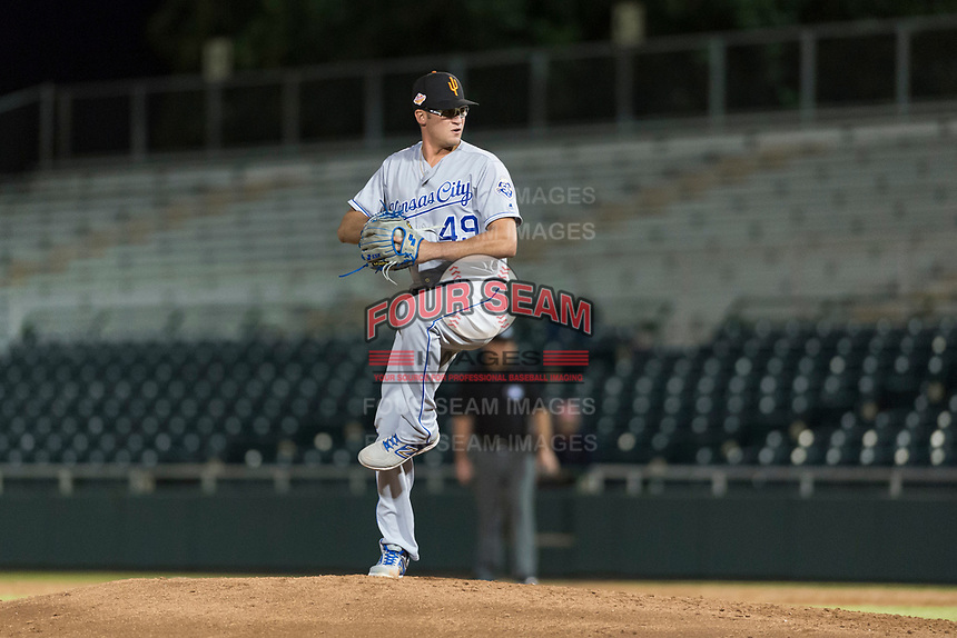 Surprise Saguaros relief pitcher Walker Sheller (49), of the Kansas City Royals, delivers a pitch during an Arizona Fall League game against the Scottsdale Scorpions at Scottsdale Stadium on October 15, 2018 in Scottsdale, Arizona. Surprise defeated Scottsdale 2-0. (Zachary Lucy/Four Seam Images)