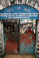 24 year old Abdul looks out from the front gates at the 'City of Rest', a rudimentary counselling and mini rehabilitation centre for recovering drug addicts, alcoholics and traumatised or delinquent youths.  It is run by a pastor who attributes the centre's success to the extensive rest, food and prayer.