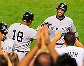 New York Yankees second baseman Robinson Cano (24) is congratulated by teammate Andruw Jones (18) after hitting his home run in the sixth inning against the Baltimore Orioles at Oriole Park at Camden Yards in Baltimore, Maryland in the second game of a doubleheader on Sunday, August 28, 2011.  Jones also homered in the sixth inning.  The Yankees won the game 8 - 3, earning a split in the two games..Credit: Ron Sachs / CNP.(RESTRICTION: NO New York or New Jersey Newspapers or newspapers within a 75 mile radius of New York City)