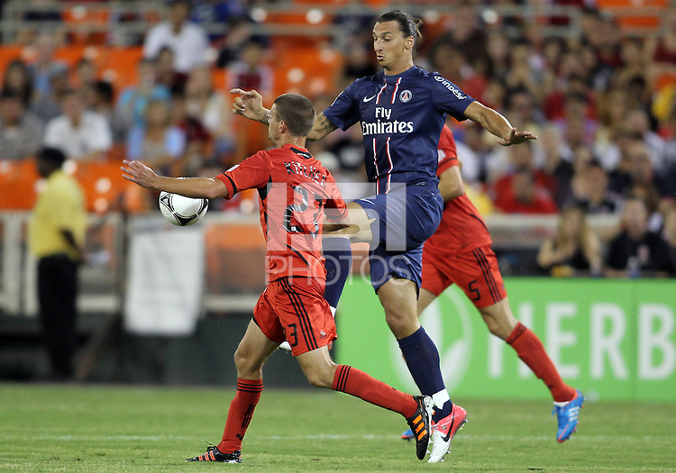 WASHINGTON, DC - July 28, 2012:  Perry Kitchen (23) of DC United chests the ball away from Zlatan Ibrahimovic (18) of PSG (Paris Saint-Germain) in an international friendly match at RFK Stadium in Washington DC on July 28. The game ended in a 1-1 tie.