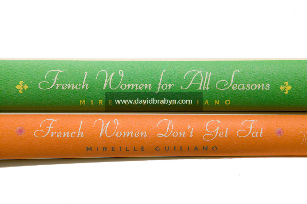 28 November 2006 - New York City, NY - Photo illustration showing Mireille Guiliano's books French Women Don't Get Fat (2004) and French Women For All Seasons (2006).