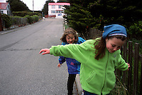 Hannah McHaffie, 9, front, and friend Bernice Hewitt, 7, stroll a street in Port Stanley, Falkland Islands. Half the country's 2,400 people live in the village.