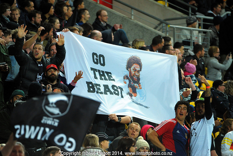Manu Vatuvei fans with a banner during the Four Nations rugby league final between the NZ Kiwis and Australia Kangaroos at Westpac Stadium, Wellington on Saturday, 15 November 2014. Photo: Dave Lintott / lintottphoto.co.nz