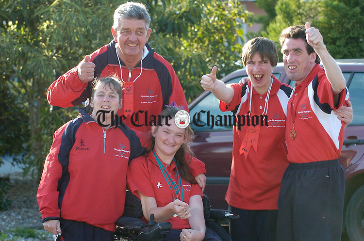 Julie Mc Donagh, Tommy Canny, Connie Commane , Edel Meaney and Tom Mc Donagh celebrate their success at the celebration homecoming night in Woodstock hotel for Clare participants in the Natonal Special Olympics. Photograph by John Kelly.